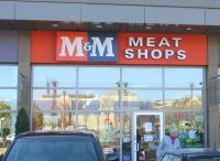 Store front for M & M Meat Shops